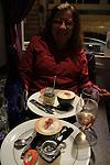 Beth having dinner along the Avenue des Champs Elysees, PAris, France.