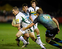Chris Ashton of Northampton Saints spots a gap in the Ospreys defence during the LV= Cup second round match between Ospreys and Northampton Saints at Riverside Hardware Brewery Field, Bridgend (Photo by Rob Munro)