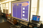 Schenectady, NY. Zoller Elementary School (urban public school). Kindergarten inclusion classroom. Digital whiteboard and laptop set up in classroom ready to take attendance in the class as students arrive. ID: AM-gKw. © Ellen B. Senisi.