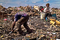 Nicaraguan kids recollect glass cullets for recycling in the garbage dump La Chureca, Managua, Nicaragua, 4 November 2004. La Chureca is the biggest garbage dump in Central America. Hundreds of trash recollectors search in tons of smouldering garbage mainly metals (copper, aluminium), others concentrate on glass which is cheap, but in bigger amount. The majority of the recyclers are families with children for whom recycling is a regular job. The children very often eat the food they find on the dump, none of them goes to school, they suffer from skin diseases, they have high levels of lead and DDT in blood.