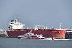 Pictured: The Red Jet passes in front of the Nave Andromeda at berth in Port of Southampton this morning, following the major incident off the east coast of the Isle of Wight after 7 stowaways were detained from the vessel after a reported hijacking. <br /> <br /> SEE OUR COPY FOR DETAILS.<br /> <br /> © Simon Czapp/Solent News & Photo Agency<br /> UK +44 (0) 2380 458800