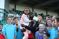 Tuesday 15th July 2014<br /> Pictured: Christian Malcolm with children<br /> RE: Welsh Sprinter Christian Malcolm surrounded by children after competing in the 4x100m relay in the Welsh Athletics International at the Cardiff International Sports Stadium, South Wales, UK. His last race on home soil.