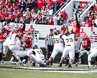 The Georgia Bulldogs beat the App State Mountaineers 45-6 in their homecoming game.  After a close first half, UGA scored 31 unanswered points in the second half.  Georgia Bulldogs linebacker Jordan Jenkins (59) jumps to deflect the field goal attempt of Appalachian State Mountaineers kicker Drew Stewart (9)