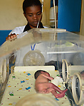 Fideline Gasengayire,  a training midwife caring for  a 27-week premature baby in an incubator at Kibuye Hospital, Karongi District, Western Rwanda