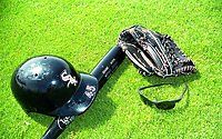 Chicago White Sox Michael Jordan's helmet, bat, glove, and sunglasses in the grass during 1994 Spring Training at the Ed Smith Stadium Complex in Sarasota, Florida.  (Tyler Bolden/Four Seam Images)