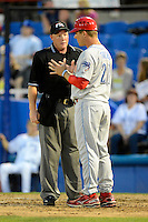 Clearwater Threshers manager Chris Truby #21 argues a call with umpire James Rackley during a game against the Dunedin Blue Jays at Florida Auto Exchange Stadium on April 4, 2013 in Dunedin, Florida.  Dunedin defeated Clearwater 4-2.  (Mike Janes/Four Seam Images)