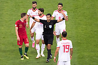 SARANSK, RUSSIA - June 25, 2018:  Referee Enrique Caceres signals a Video Assistant Referee call after Iran defender Morteza Pouraliganji was fouled by Portugal's Cristiano Ronaldo in their 2018 FIFA World Cup group stage match at Mordovia Arena. Caceres gave Ronaldo a yellow card for the foul.