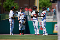 Rochester Red Wings third baseman Brian Schales (13), shortstop Drew Maggi (5), first baseman Zander Wiel (12), and second baseman Nick Gordon (1) during an International League game against the Scranton/Wilkes-Barre RailRiders on June 25, 2019 at Frontier Field in Rochester, New York.  Rochester defeated Scranton 10-9.  (Mike Janes/Four Seam Images)