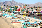 Panga boats on the seaside,<br /> commercial industries on the street side,boardwalk (malecon)<br /> (4)