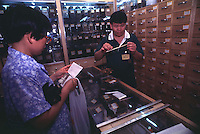 SELLING CHINESE HERBAL MEDICINE TO MAKE A BAY BOY AT A CHINESE MEDICINE SHOP IN GUANGZHOU, CHINA.  <br /> ©sinopix