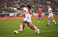 JACKSONVILLE, FL - NOVEMBER 10: Tobin Heath #17 of the United States and Shirley Cruz #10 of Costa Rica battle for a ball during a game between Costa Rica and USWNT at TIAA Bank Field on November 10, 2019 in Jacksonville, Florida.
