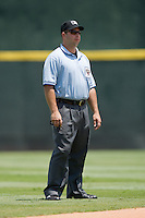 Third base umpire Mark Lollo during the International League game between the Louisville Bats and the Charlotte Knights at Knights Stadium July 20, 2010, in Fort Mill, South Carolina.  Photo by Brian Westerholt / Four Seam Images