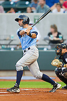 Nicholas Francis #7 of the Wilmington Blue Rocks follows through on his swing against the Winston-Salem Dash at  BB&T Ballpark August 4, 2010, in Winston-Salem, North Carolina.  Photo by Brian Westerholt / Four Seam Images