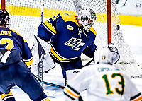 26 January 2019: Merrimack College Warrior Goaltender Logan Halladay, a Sophomore from Cary, NC, watches the puck hit the outside of the net in the third period against the University of Vermont Catamounts at Gutterson Fieldhouse in Burlington, Vermont. The Warriors fell to the Catamounts 4-3 in overtime after tying up the game in the dyeing seconds of the third period of their America East conference game. Mandatory Credit: Ed Wolfstein Photo *** RAW (NEF) Image File Available ***