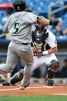 Lake County Captains catcher Richard Stock (28) gets ready to tag out Sammy Diaz (5) attempting to score a run during a game against the Dayton Dragons on June 8, 2014 at Classic Park in Eastlake, Ohio.  Lake County defeated Dayton 4-2.  (Mike Janes/Four Seam Images)