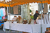 Man selling sausages of donkey, cow, wild boar and more at The market in Carpentras, Vaucluse, Rhone, Provence, France