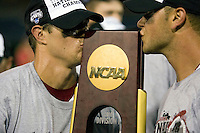 South Carolina 2B Scott Wingo and 1B Christian Walker kiss the championship trophy following Game Two of the NCAA Division One Men's College World Series Finals on June 29th, 2010 at Johnny Rosenblatt Stadium in Omaha, Nebraska.  (Photo by Andrew Woolley / Four Seam Images)