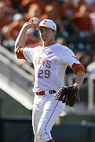 Texas Longhorns pitcher Corey Knebel #29 makes a pickoff throw to first base against the Oklahoma Sooners in the NCAA baseball game on April 6, 2013 at UFCU DischFalk Field in Austin, Texas. The Longhorns defeated the rival Sooners 1-0. (Andrew Woolley/Four Seam Images).