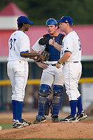 Burlington Manager Darryl Kennedy (9) gives instructions to Yensi Lopez (37) as Tom Hill (44) looks on at Burlington Athletic Park in Burlington, NC, Monday, August 6, 2007.