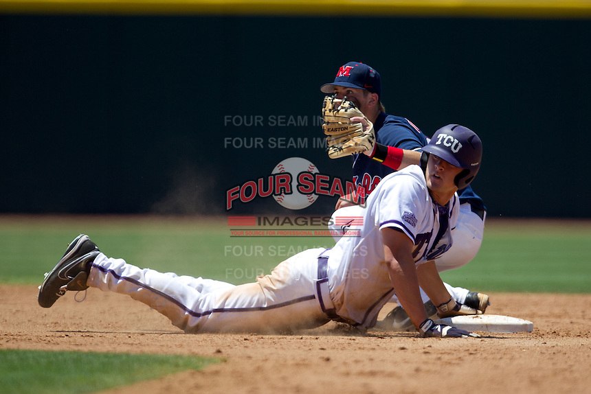 Outfielder Jerrick Suiter #31 of the Texas Christian University Horned Frogs dives back to second base eluding the tag of Jake Overbay #22 during the NCAA Regional baseball game against the Ole Miss Rebels on June 1, 2012 at Blue Bell Park in College Station, Texas. Ole Miss defeated TCU 6-2. (Andrew Woolley/Four Seam Images).
