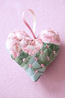 A close up of a handmade heart-shaped Christmas decoration