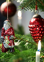 The Christmas tree is decorated with an imaginative variety of traditional glass ornaments