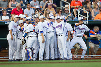 Florida Gators team huddle before their game against the Miami Hurricanes in the NCAA College World Series on June 13, 2015 at TD Ameritrade Park in Omaha, Nebraska. Florida defeated Miami 15-3. (Andrew Woolley/Four Seam Images)