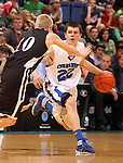SIOUX FALLS, SD - MARCH 17: St. Thomas More's Taylor Klapperich brings the ball up against Dakota Valley's Brody VanGinkel in the first half of the 2012 Class A Boys Basketball Championship Saturday night at the Sioux Falls Arena.  (Photo by Dave Eggen/Inertia)