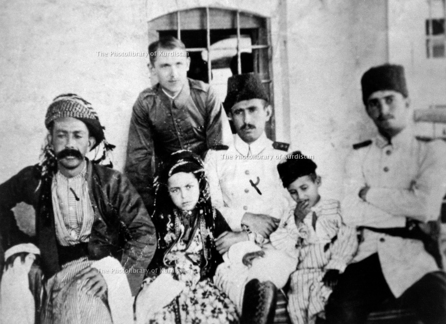 Iraq 1918.In Suleimania, left, Sheikh Mahmoud Barzanji, standing a german officer, next Fatah Beg Amin Attar and the little boy, Sheikh Raouf, son of Sheikh Mahmoud.Irak 1918.A Souleimania, a gauche, sheikh Mahmoud Barzanji, debout, un officier allemand, a cote, Fatah Beg Amin Attar et le petit garcon, Sheikh Raouf, fils de Sheikh Mahmoud