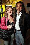 Sally Kolenda and Reginald Adams at the Realcity Literacy party at 13 Celsius Thursday Feb. 18,2010. (Dave Rossman Photo)