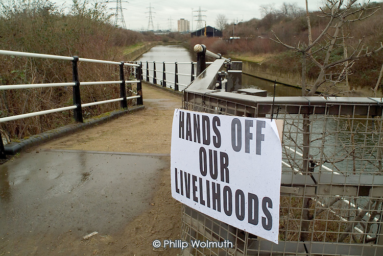 Protest posters on a path by the City Mill River, a branch of the River Lea in Stratford, East London. The river crosses the proposed site of the 2012 Olympics. Employees of some of the many local businesses are concerned that they may lose their jobs if firms are forced to relocate out of the area.