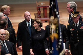 President Donald Trump, left, looks at former Florida Gov. Jeb Bush, right, as Bush family members follow the flag-draped casket of former President George H.W. Bush as he is carried out by a military honor guard during a State Funeral at the National Cathedral, Wednesday, Dec. 5, 2018, in Washington. Also pictured is President Donald Trump's Chief of Staff John Kelly, bottom left, and former first lady Laura Bush, center.<br /> Credit: Andrew Harnik / Pool via CNP