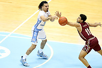 CHAPEL HILL, NC - FEBRUARY 1: Cole Anthony #2  of the University of North Carolina passes the ball past Derryck Thornton #11 of Boston College during a game between Boston College and North Carolina at Dean E. Smith Center on February 1, 2020 in Chapel Hill, North Carolina.