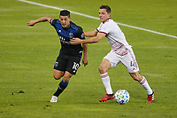 SAN JOSE, CA - OCTOBER 28: Cristian Espinoza #10 of the San Jose Earthquakes battles for the ball with Donny Toia #4 of Real Salt Lake during a game between Real Salt Lake and San Jose Earthquakes at Earthquakes Stadium on October 28, 2020 in San Jose, California.