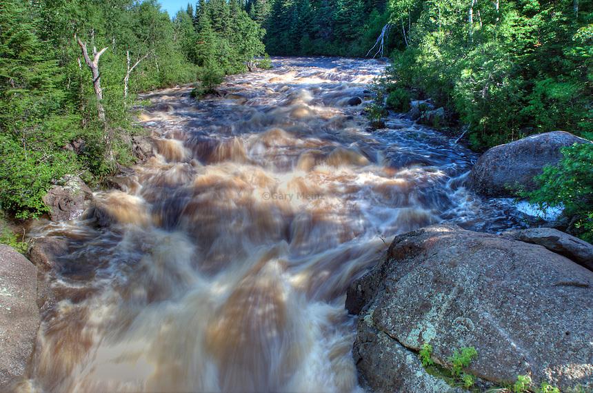 Rushing river due to heavy rain, Poplar River at Lutsen Mountains, Lutsen Minnesota