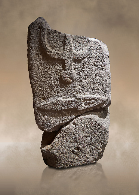 Central fragment of a Late European Neolithic prehistoric Menhir standing stone with carvings on its face side. The representation of a stylalised male figure would have started at the top with the remaons of  a carving of a falling figure with head at the bottom and 2 curved arms encircling a body above. at the bottom is a carving of a dagger running horizontally across the menhir.  Excavated from Piscina 'E Sali VI site,  Laconi. Menhir Museum, Museo della Statuaria Prehistorica in Sardegna, Museum of Prehoistoric Sardinian Statues, Palazzo Aymerich, Laconi, Sardinia, Italy