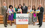 Ken Huewitt poses for a photograph with elementary honorees after a Children at Risk awards presentation to area schools at Pilgrim Academy, June 6, 2016.