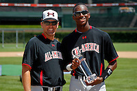 Outfielder Lewis Brinson #18 of Coral Springs High School in Florida is presented the home run derby trophy by Baseball Factory's Steve Bernhardt during the Under Armour All-American Game at Wrigley Field on August 13, 2011 in Chicago, Illinois.  (Mike Janes/Four Seam Images)