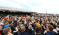Jazzi Barnum-Bobb of Newport County and Sid Nelson celebrates with fans during a pitch invasion after the final whistle as a late goal from Mark O'Brien secures safety for Newport to stay in League two during the Sky Bet League Two match between Newport County and Notts County at Rodney Parade, Newport, Wales, UK. Saturday 06 May 2017