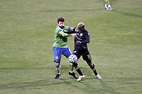 COLUMBUS, OH - DECEMBER 12: Gyasi Zardes #11 of the Columbus Crew and Joao Paulo #6 of the Seattle Sounders FC challenge for the ball during a game between Seattle Sounders FC and Columbus Crew at MAPFRE Stadium on December 12, 2020 in Columbus, Ohio.