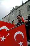 Turkey, Istanbul. A vendor with the Turkish flag