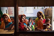 Caretakers and families wait to consult the health workers at the government health centre in  Hanuman Nagar, Saptari, Nepal.