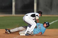 Greg Annarummo #23 of the Rhode Island Rams slides into third base against the Cal State Northridge Matadors at Matador Field on March 14, 2012 in Northridge,California. Rhode Island defeated Cal State Northridge 10-8.(Larry Goren/Four Seam Images)