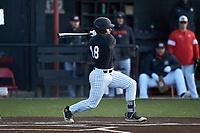 Jacob Mulcahy (18) of the Bellarmine Knights follows through on his swing against the North Greenville Crusaders at Ashmore Park on February 7, 2020 in Tigerville, South Carolina. The Crusaders defeated the Knights 10-2. (Brian Westerholt/Four Seam Images)