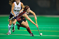 STANFORD, CA - OCTOBER 21, 2011: Redshirt Junior Katie Mitchell passes during the game between Stanford field hockey and UC Davis at the Varsity Field Hockey Turf in Stanford, California on October 21, 2011.  Stanford defeated UC Davis, 5-0.