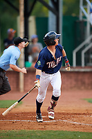 Elizabethton Twins second baseman Michael Helman (13) follows through on a swing during a game against the Bristol Pirates on July 29, 2018 at Joe O'Brien Field in Elizabethton, Tennessee.  Bristol defeated Elizabethton 7-4.  (Mike Janes/Four Seam Images)