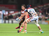24th September 2021;  Kingsholm Stadium, Gloucester, England; Gallaher Premiership Rugby, Gloucester Rugby versus Leicester Tigers: Lloyd Evans of Gloucester passes under pressure from George Martin of Leicester Tigers
