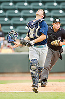Myrtle Beach Pelicans catcher Brett Nicholas #28 tracks a foul pop fly during the Carolina League game against the Winston-Salem Dash at BB&T Ballpark on July 5, 2012 in Winston-Salem, North Carolina.  The Dash defeated the Pelicans 12-5.  (Brian Westerholt/Four Seam Images)