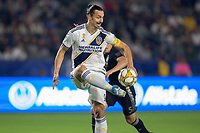 CARSON, CA - SEPTEMBER 15: Zlatan Ibrahimovic #9 of the Los Angeles Galaxy traps a ball during a game between Sporting Kansas City and Los Angeles Galaxy at Dignity Health Sports Park on September 15, 2019 in Carson, California.