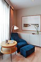 blue armchair in the bedroom
